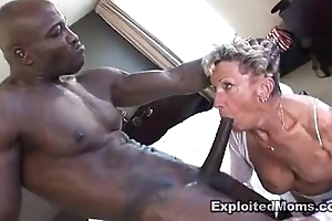 Superannuated granny takes a chunky Stygian cock just about will not hear of arse anal interracial peel