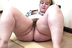 A chubby dame with a muted bawdy cleft masturbates with a cucumber